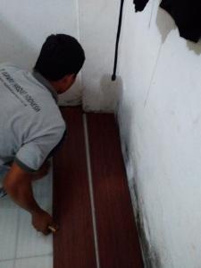 pemasangan lantai kayu laminated